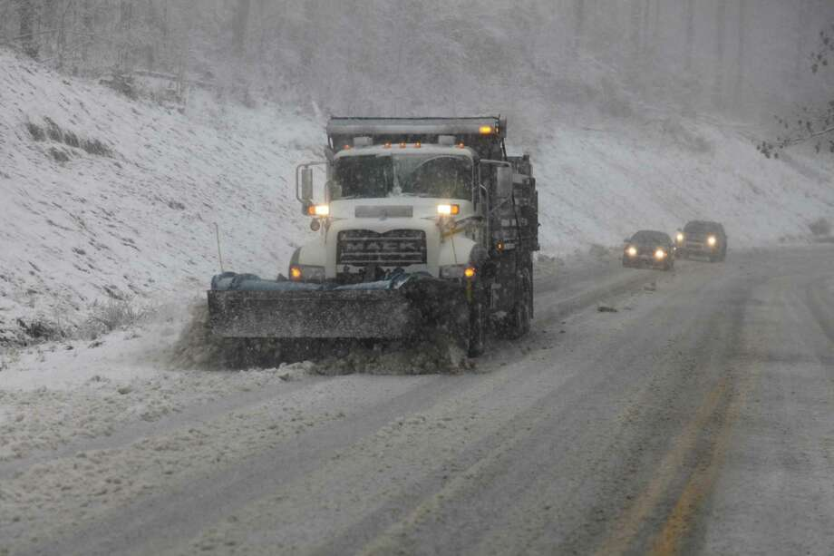 Snow plows thunder through the mountains of West Virginia as the superstorm began its raking of the region Monday. The higher elevations could see 2-3 feet of snow and blizzard conditions through Tuesday. Photo: Robert Ray, STF / AP