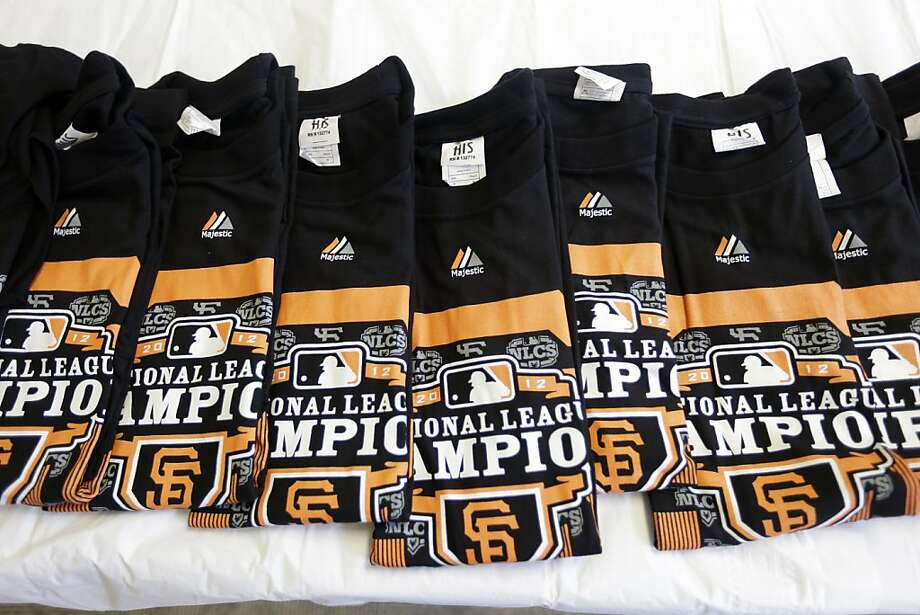 Counterfeit San Francisco Giants T-shirts are displayed in San Francisco, Monday, Oct. 29, 2012. Agents with the U.S. Department of Homeland Security seized nearly 1,200 items of counterfeit MLB clothing being offered for sale by vendors on San Francisco streets. The merchandise included more than 1,000 phony T-shirts, along with counterfeit baseball hats and knit caps. The department estimated the value of the goods, if they were genuine, at $25,000. (AP Photo/Marcio Jose Sanchez) Photo: Marcio Jose Sanchez, Associated Press