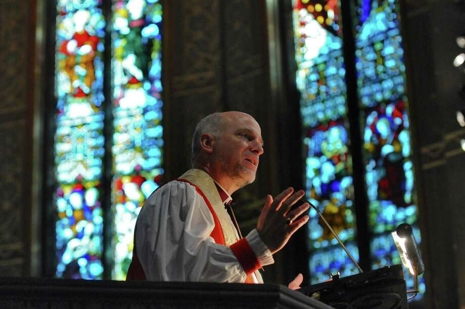 The Rt. Rev. William H. Love, Bishop of Albany, delivers the sermon at St. Peter's Episcopal Church during a  service to begin the church's year long celebration of its 300th anniversary,  on Sunday Feb. 5, 2012 in Albany, NY.    (Philip Kamrass / Times Union archive) Photo: Philip Kamrass / 00016254A