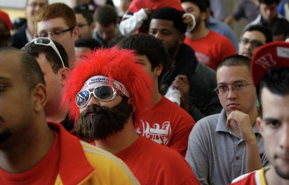 """Houston Rockets Red Red Rowdy Ruben Robles pay homage to the prominent beard of newly acquired guard James Harden as he and other fans listen during a media conference at Toyota Center, 1510 Polk Street, Monday, Oct. 29, 2012, in Houston. Harden is known for his long time beard and the saying  """"Fear the Beard"""". Photo: Melissa Phillip, Houston Chronicle / © 2012 Houston Chronicle"""
