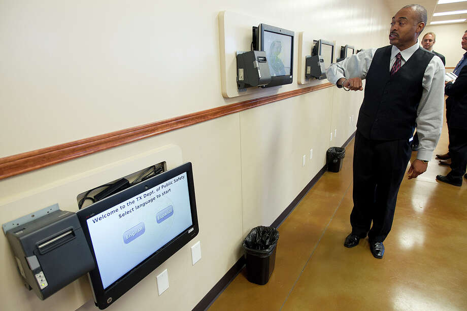 The Texas Department of Public Safety gives the public a preview of its new driver's license mega center in Pflugerville on Monday. An employee demonstrates some of the technology designed to reduce wait times. Photo: HANDOUT / New