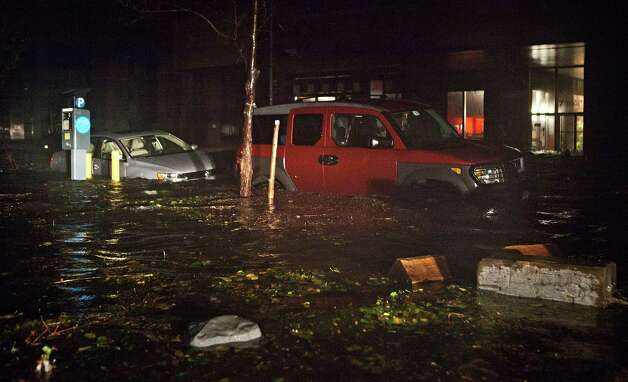 NEW YORK, NY - OCTOBER 29:  Flooded cars, caused by Hurricane Sandy, are seen on October 29, 2012, in the Financial District of New York, United States. Hurricane Sandy, which threatens 50 million people in the eastern third of the U.S., is expected to bring days of rain, high winds and possibly heavy snow. New York Governor Andrew Cuomo announced the closure of all New York City will bus, subway and commuter rail service as of Sunday evening Photo: Andrew Burton, Getty Images / Getty Images North America