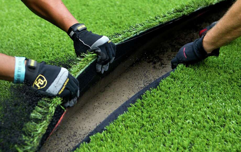 A more forgiving brand of AstroTurf than was used in the Astrodome is ready for play at Reliant Stadium. Photo: Cody Duty, Staff / Houston Chronicle