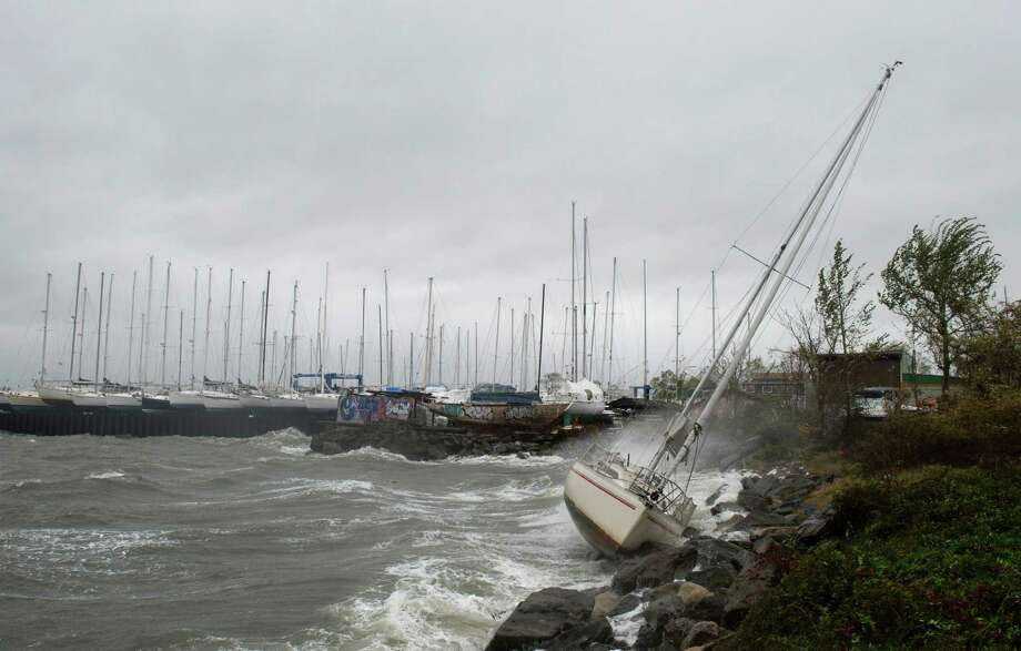 A sailboat smashes on the rocks after breaking free from its mooring on City Island October 29, 2012 in New York. Hurricane Sandy's winds picked up speed as the storm made a left turn toward the East Coast.    AFP PHOTO/DON EMMERTDON EMMERT/AFP/Getty Images Photo: DON EMMERT / AFP