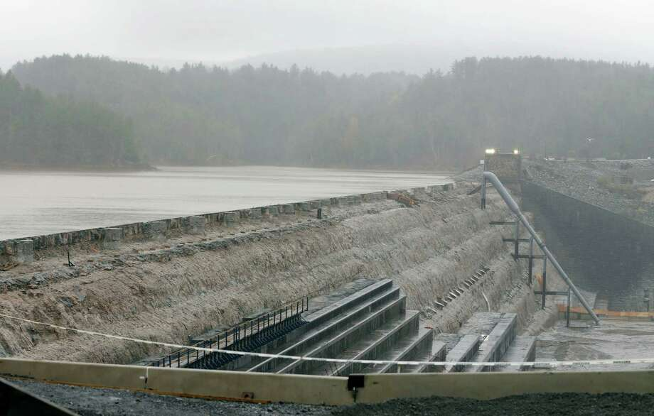 The Schoharie Reservoir is held back by the Gilboa Dam on Monday, Oct. 29, 2012, in Gilboa, N.Y. The reservoir is a source of New York City's drinking water and possible overflow from the approaching Hurricane Sandy is a concern for local residents. Hurricane Sandy continued on its path Monday, as the storm forced the shutdown of mass transit, schools and financial markets, sending coastal residents fleeing, and threatening a dangerous mix of high winds and soaking rain. (AP Photo/Mike Groll) Photo: Mike Groll