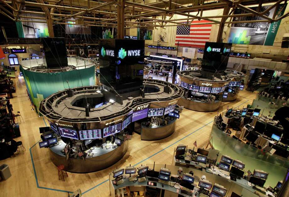 The floor of the New York Stock Exchange is empty of traders, Monday, Oct. 29, 2012, in New York. All major U.S. stock and options exchanges will remain closed Monday with Hurricane Sandy nearing landfall on the East Coast. Trading has rarely stopped for weather. A blizzard led to a late start and an early close on Jan. 8, 1996, according to the exchange's parent company, NYSE Euronext. The NYSE shut down on Sept. 27, 1985 for Hurricane Gloria. (AP Photo/Richard Drew) Photo: Richard Drew