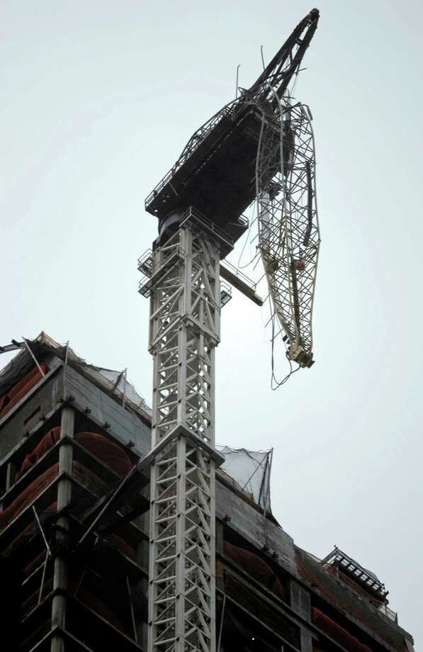 A crane hangs ominously from a 90-story building in New York City. Photo: Peter Foley