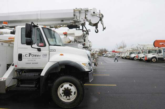 Electrical line crew trucks fill a section of the parking lot at The Desmond Hotel on Monday, Oct. 29, 2012 in Colonie, NY.  Line crews from outside the area have been brought into the area to help with recovery from Hurricane Sandy.    (Paul Buckowski / Times Union) Photo: Paul Buckowski