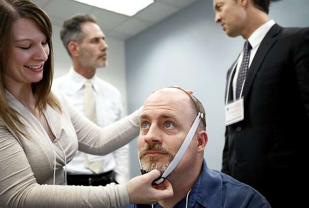 Dr. Emily Kappenman (left) prepares psychologist Michael Callaghan for transcranial direct current stimulation. Photo: Sarah Rice, Special To The Chronicle / SF