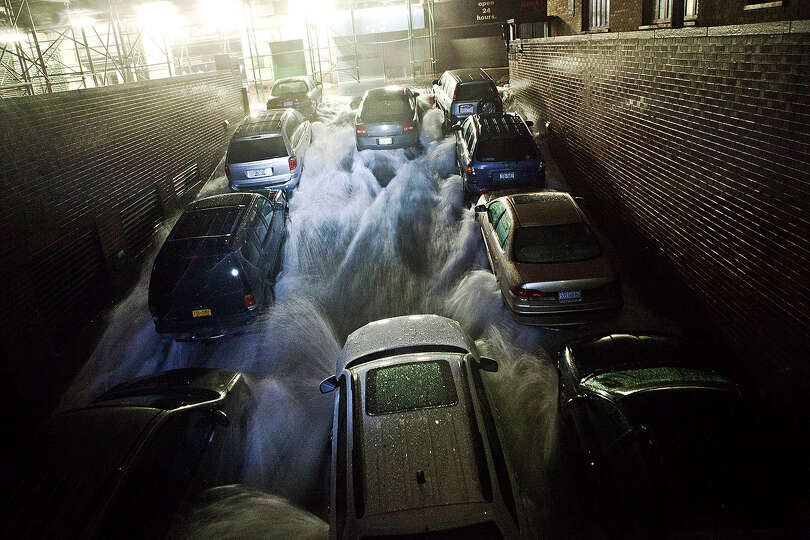 Rising water, caused by Hurricane Sandy,  rushes into a subterranian parking garage on October 29, 2