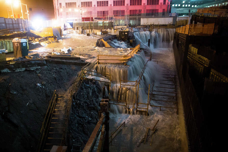 Sea water floods the Ground Zero construction site, Monday, Oct. 29, 2012, in New York. Sandy continued on its path Monday, as the storm forced the shutdown of mass transit, schools and financial markets, sending coastal residents fleeing, and threatening a dangerous mix of high winds and soaking rain.  Photo: John Minchillo, AP / AP2012