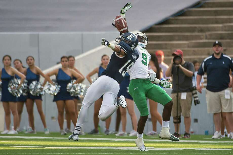 Rice's Phillip Gaines, left, found a silver lining in his lost season. Now he's golden at cornerback for Rice. Photo: Smiley N. Pool, Staff / Houston Chronicle