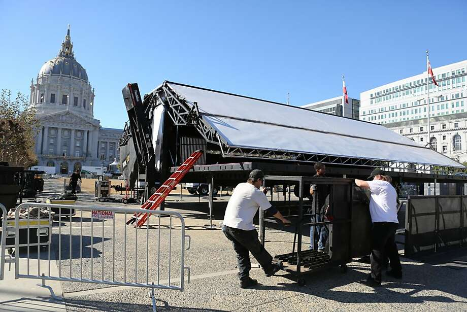 At City Hall, where Wednesday's parade will finish, workers set up a barrier in front of a giant video monitor. Photo: Rashad Sisemore, The Chronicle