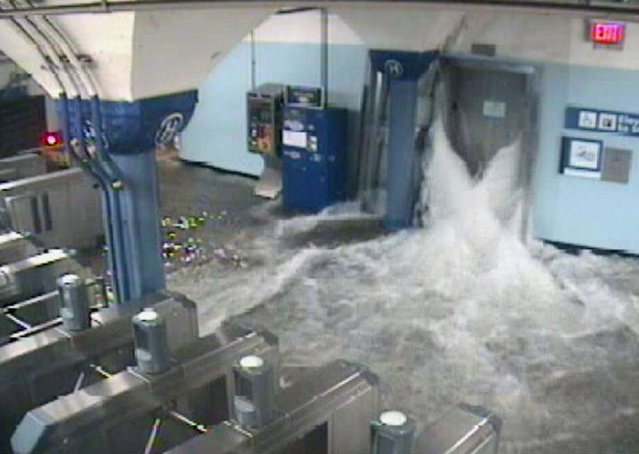 In this photo provided by the Port Authority of New York and New Jersey a surveillance camera captures the PATH station in Hoboken, N.J., as it is flooded shortly before 9:30 p.m. EDT on Monday, Oct. 29, 2012. Sandy continued on its path Monday, as the storm forced the shutdown of mass transit, schools and financial markets, sending coastal residents fleeing, and threatening a dangerous mix of high winds and soaking rain. Photo: AP