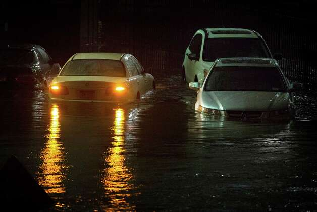 Vehicles are submerged during a storm surge near the Brooklyn Battery Tunnel, Monday, Oct. 29, 2012, in New York. Superstorm Sandy zeroed in on New York's waterfront with fierce rain and winds that shuttered most of the nation's largest city Monday, darkened the financial district and left a huge crane hanging off a luxury high-rise. Photo: AP