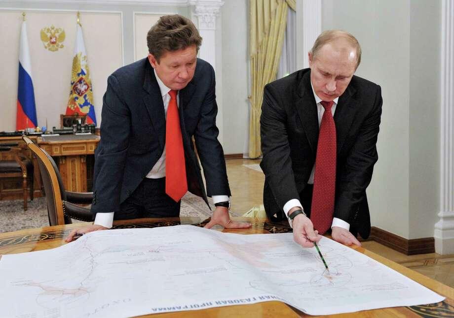 Russian President Vladimir Putin, right, meets with Gazprom head Alexei Miller on Monday in Moscow. Photo: Alexei Nikolsky, POOL / RIA Novosti Kremlin
