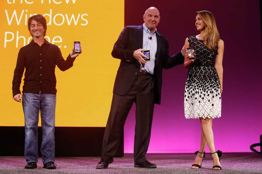 Microsoft brought along actress Jessica Alba for its release event Monday in San Francisco.With her are Microsoft CEO Steve Ballmer, center, and executive Joe Delfiore. The launch marks the company's latest effort in the cellphone market. Photo: Stephen Lam, Stringer / Getty Images North America