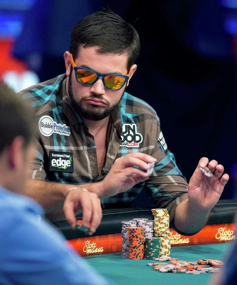 Robert Salaburu of San Antonio stacks his chips after winning a hand during the World Series of Poker Final Table event, Monday, Oct. 29, 2012, in Las Vegas. (AP Photo/Julie Jacobson) Photo: Julie Jacobson, Associated Press / AP