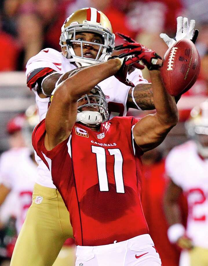 San Francisco 49ers defensive back Chris Culliver breaks up a pass intended for Arizona Cardinals wide receiver Larry Fitzgerald (11) during the first half of an NFL football game, Monday, Oct. 29, 2012, in Glendale, Ariz. (AP Photo/Paul Connors) Photo: Paul Connors, Associated Press / FR5880 AP