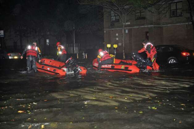 FDNY inflatable boats travel along 14th street towards the East River on a rescue mission in the wake of Hurricane Sandy, Monday, Oct. 29, 2012, in New York. Sandy continued on its path Monday, as the storm forced the shutdown of mass transit, schools and financial markets, sending coastal residents fleeing, and threatening a dangerous mix of high winds and soaking rain. Photo: AP