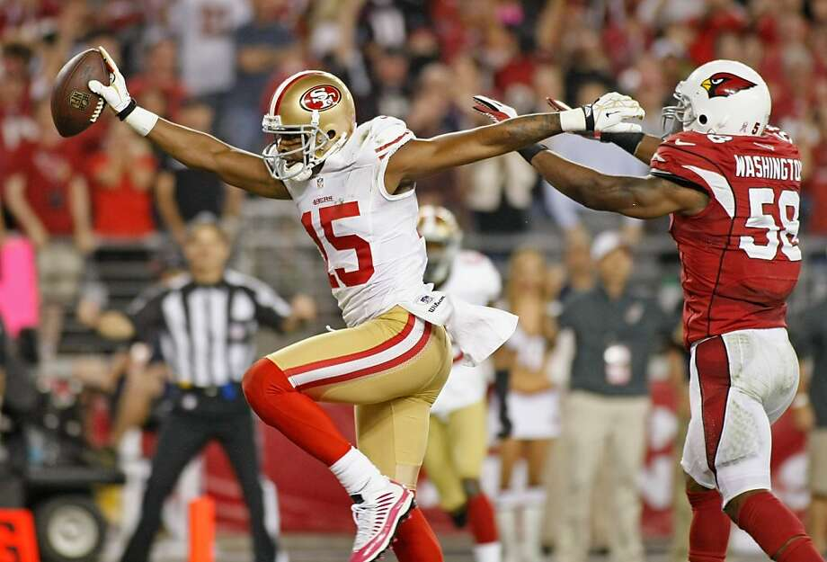 49ers wide receiver Michael Crabtree shows off his wingspan as he scores his second touchdown of the night, a 9-yarder from Alex Smith in the second quarter. Photo: Ralph Freso, Getty Images