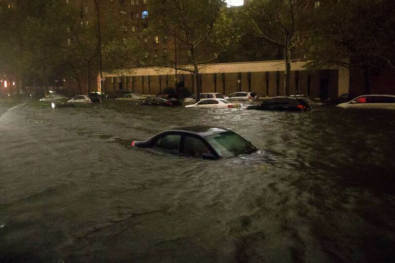 A vehicle is submerged on 14th Street near the Consolidated Edison power plant, Monday, Oct. 29, 201