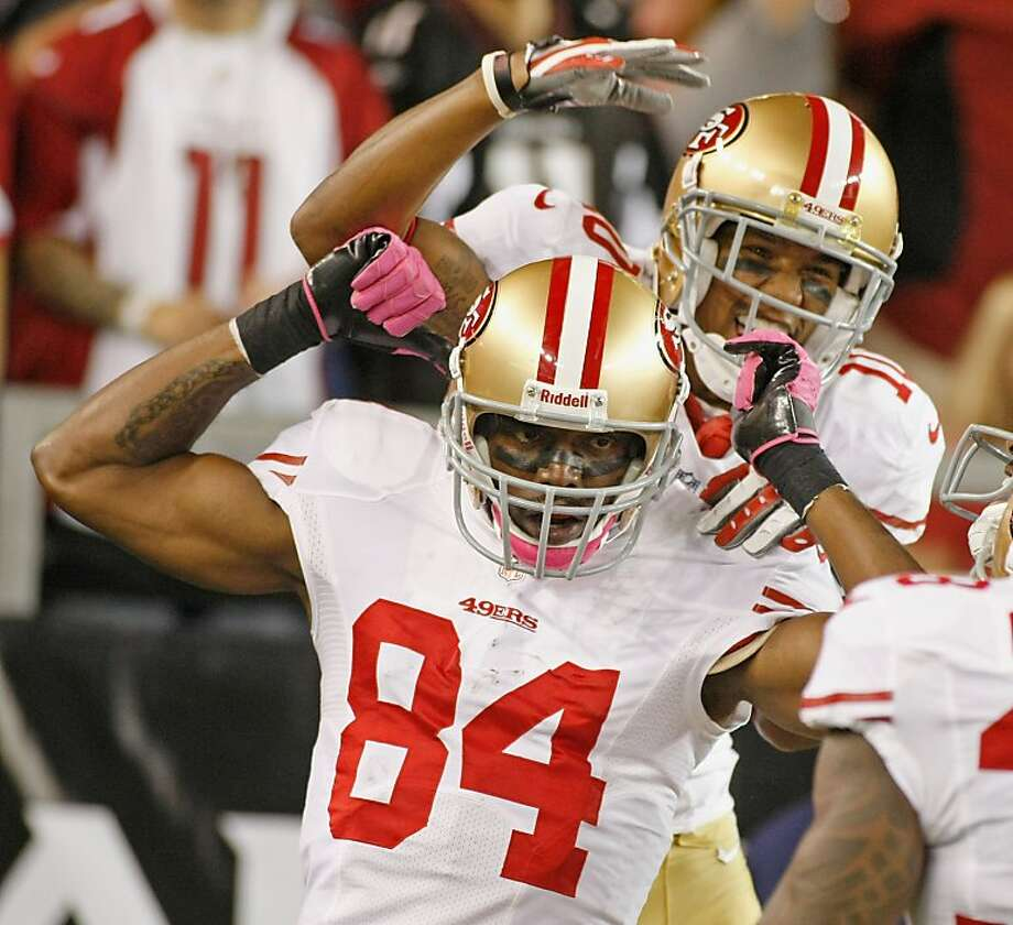 Randy Moss (84) celebrates with Kyle Williams after Moss' 47-yard touchdown reception. Photo: Ralph Freso, Getty Images