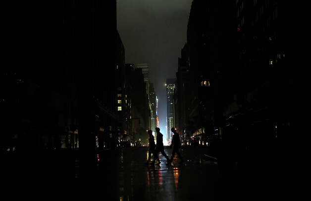 Power outage seen  on October 29, 2012 in Manhattan, New York. Hurricane Sandy, which threatens 50 million people in the Mid-Atlantic area of the United States, is expected to bring days of rain, high winds and possibly heavy snow. New York Governor Andrew Cuomo announced the closure of all New York City bus, subway and commuter rail services as of Sunday evening. Photo: Allison Joyce, Getty Images / 2012 Getty Images