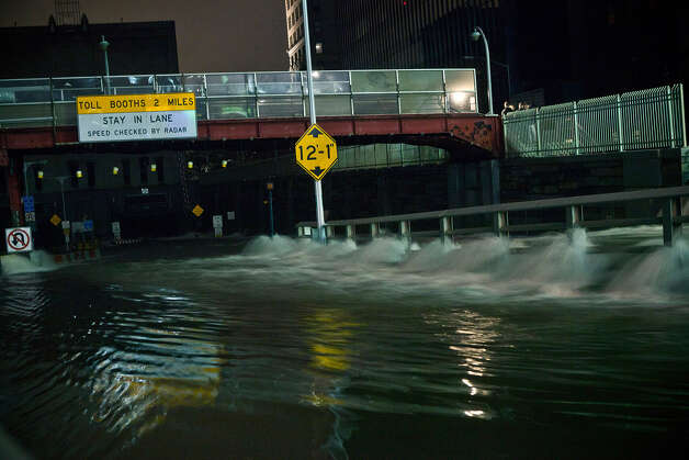 Water rushes into the Carey Tunnel (previously the Brooklyn Battery Tunnel), caused by Hurricane Sandy, October 29, 2012, in the Financial District of New York, United States. Hurricane Sandy, which threatens 50 million people in the eastern third of the U.S., is expected to bring days of rain, high winds and possibly heavy snow. New York Governor Andrew Cuomo announced the closure of all New York City will bus, subway and commuter rail service as of Sunday evening. Photo: Andrew Burton, Getty Images / 2012 Getty Images