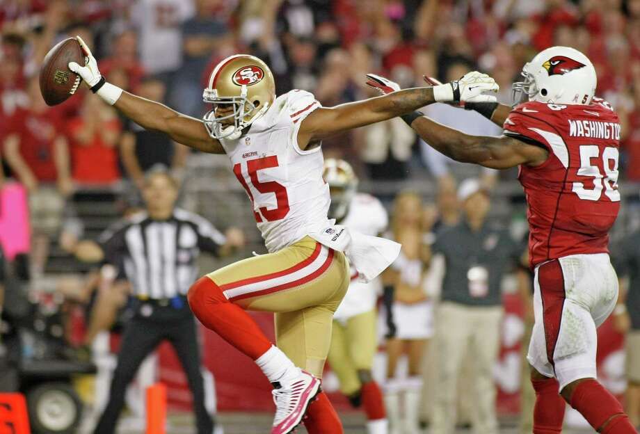 49ers receiver Michael Crabtree (15) high-steps into the end zone as he beats the Cardinals' Daryl Washington on a 9-yard TD catch in the second quarter. Photo: Ralph Freso, Stringer / Getty Images North America