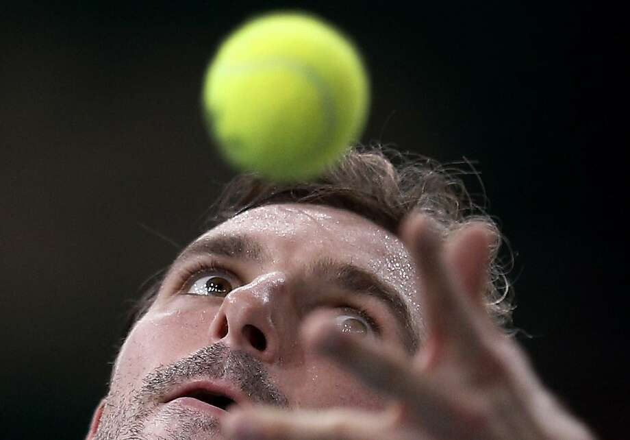 France's Julien Benneteau serves to Viktor Troicki of Serbia, during their match at the Paris Tennis Masters tournament, Monday, Oct. 29, 2012. (AP Photo/Christophe Ena) Photo: Christophe Ena, Associated Press