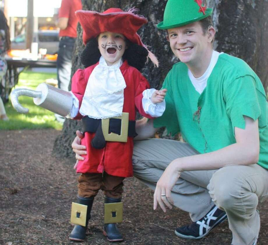 """FINALIST! Molly Christensen says the whole family -- including 2-year-old Finn and dad Peter -- is going with a """"Peter Pan"""" theme: """"Captain Hook's costume credit goes to his Grandma.  The hat and hook were also used by Finn's dad when he was a kid.  Peter Pan's costume was just an oversized t-shirt and some yarn.  No sewing involved!"""""""