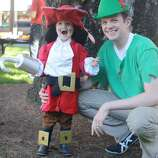 "FINALIST! Molly Christensen says the whole family -- including 2-year-old Finn and dad Peter -- is going with a ""Peter Pan"" theme: ""Captain Hook's costume credit goes to his Grandma.  The hat and hook were also used by Finn's dad when he was a kid.  Peter Pan's costume was just an oversized t-shirt and some yarn.  No sewing involved!"""