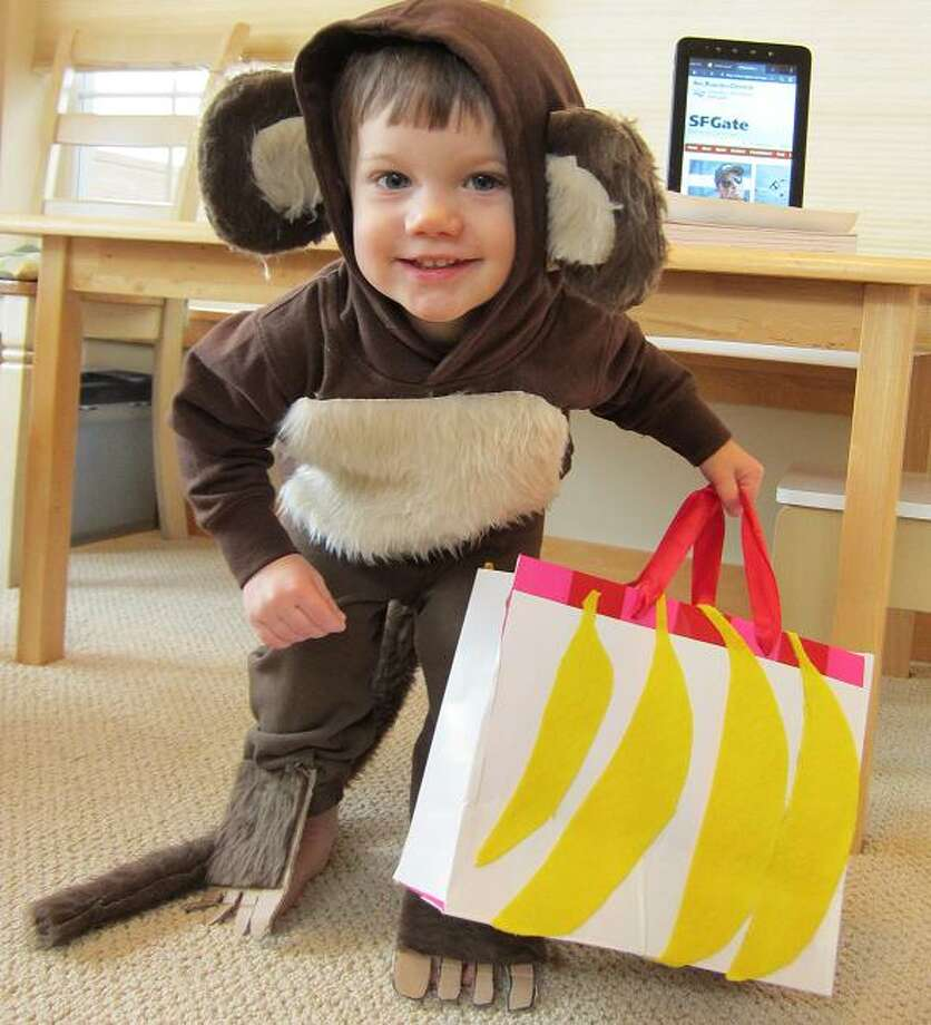 "FINALIST! Shannon and Warwick have been following the contest for years, and this monkey costume is an excellent first attempt. Two-year-old Nicholas ""doesn't use many words but is adept at making monkey noises and gets very excited when he sees monkeys or bananas.  Hence the monkey costume."""