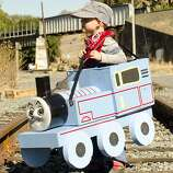 "FINALIST! This is easily our best train year ever for the contest. Mother Lizz Porter reports that 4-year-old Max's dad took a day off work to put together this Thomas. Side note: I'm getting a strong ""Stand By Me"" vibe from this photo. (That would actually make a nice family video. Make sure you use an abandoned track.)"