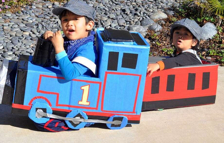 "FINALIST! It's always good to have a willing little brother around to play the caboose. Mother Jasmin A. writes: ""Created out of shipping boxes, take out containers, old belts, blue painter's tape and the wonderful invention of different colored duct tape!"""