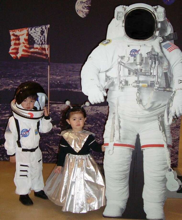 "FINALIST! Marie S. gets points from bringing little sister's alien costume (with brother's store-bought astronaut) to an actual NASA facility. ""Gotta love love living in the Bay Area where you can go to NASA Ames Research Center and take cool pictures like this!"""