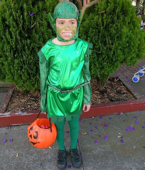 """FINALIST! Sue Denim's daughter is the Green Goblin: """"I sewed this costume myself altering a pattern that I found for a knight. I bought the ears and painted them green. The belt is a green glitter belt that I wore in my glory days of being a glitter-queen in the 70's."""""""