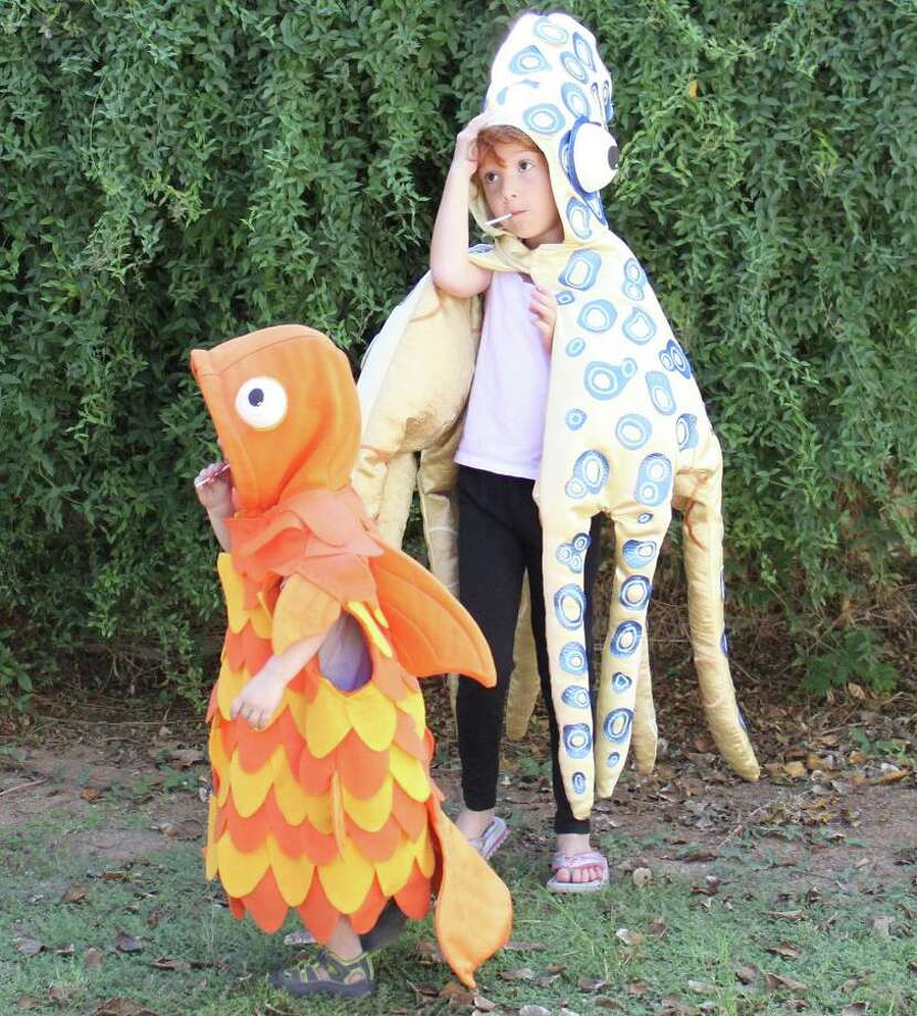 FINALIST! Julie B. submitted these blue-ringed octopus and goldfish costumes with no extended e-mail note. I thought that was a bold move, kind of like calling your shot in baseball. Bonus points for the Kojak-like suckers in the kids' mouths.