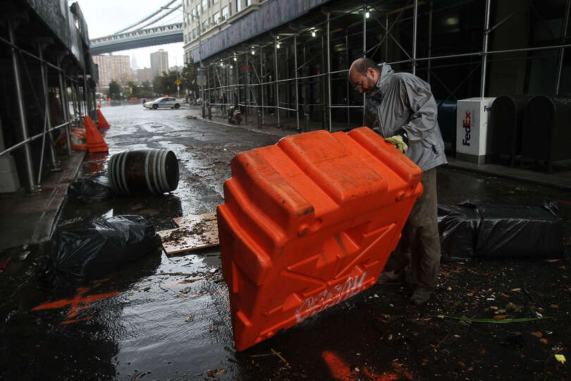Portable, upended flood dikes are viewed on a flooded street in the Dumbo section of Brooklyn after