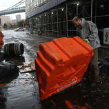 Portable, upended flood dikes are viewed on a flooded street in the Dumbo section of Brooklyn after the city awakens to the affects of Hurricane Sandy on October 30, 2012 in New York, United States. At least 15 people were reported killed in the United States by Sandy as millions of people in the eastern United States have awoken to widespread power outages, flooded homes and downed trees. New York City was his especially hard with wide spread power outages and significant flooding in parts of the city.