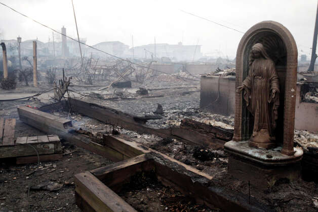 Damage caused by a fire at Breezy Point is shown Tuesday, Oct. 30, 2012, in New York. A fire department spokesman says more than 190 firefighters are at the blaze in the Breezy Point section. Fire officials say the blaze was reported around 11 p.m. Monday in an area flooded by the superstorm that began sweeping through earlier. Photo: Frank Franklin II, AP / AP2012