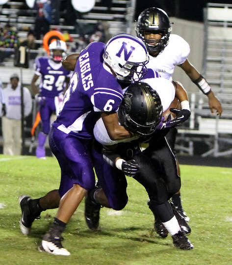 Newton's defense closes in on an Anahuac runner.