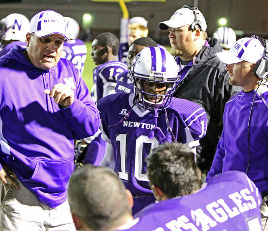 W.T. Johnston talks with his players during Friday's victory. Photo: Charles Kerr