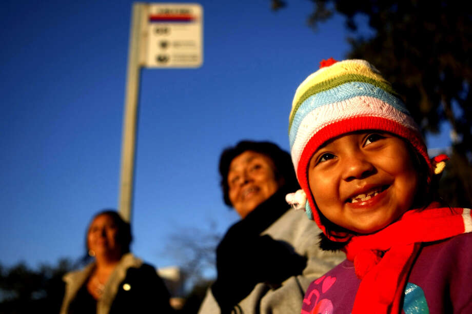 Bundled up, Elianna Grimaldo, 6, waits for the bus with her grandmother, Maria Hernandez, and mother, Juana Reyes, Tuesday Oct. 30, 2012, in the Texas Medical Center. Photo: Johnny Hanson, .