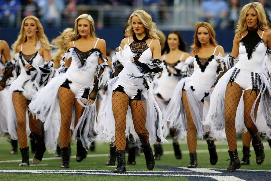 Members of the Dallas Cowboys cheerleaders perform at halftime dressed in halloween costume during an NFL football game against the New York Giants Sunday, Oct. 28, 2012, in Arlington, Texas. The Giants defeated the Cowboys 29-24.  (AP Photo/Sharon Ellman) Photo: Sharon Ellman, Associated Press / FR170032 AP