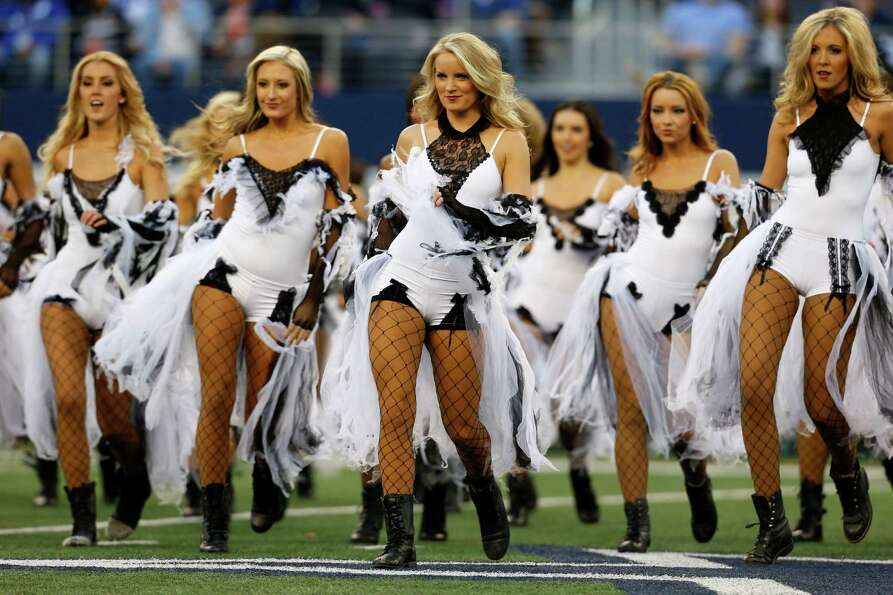 Members of the Dallas Cowboys cheerleaders perform at halftime dressed in halloween costume during a