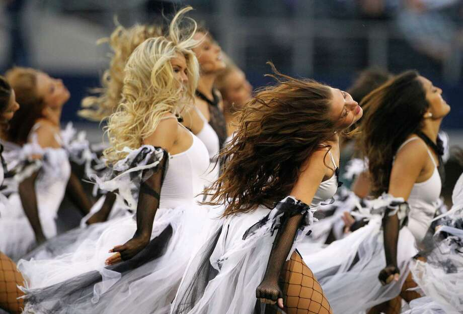 Members of the Dallas Cowboys cheerleaders perform in halloween costume in a halftime show during an NFL football game against the New York Giants Sunday, Oct. 28, 2012, in Arlington, Texas. The Giants defeated the Cowboys 29-24. (AP Photo/Tony Gutierrez) Photo: Tony Gutierrez, Associated Press / AP