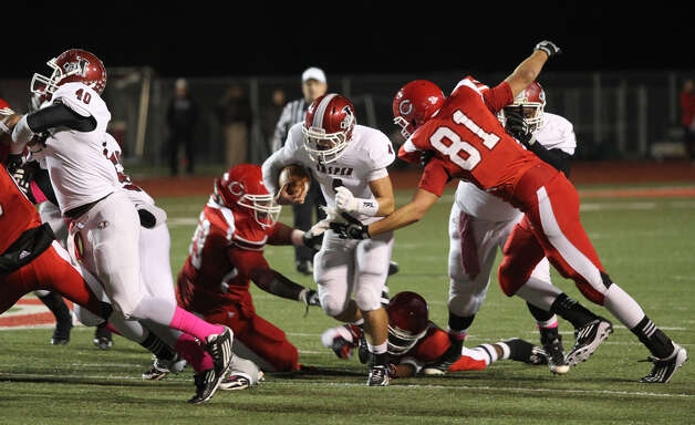 Steven Walker breaks up the middle during Friday's loss to Carthage. Photo: Jason Dunn