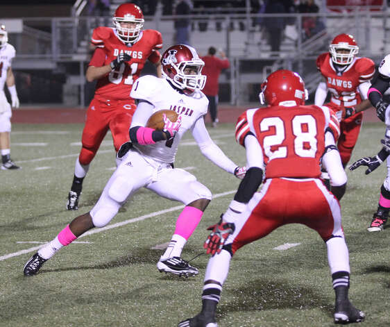 Demarcus Collins looks for a break in the Carthage defense. Photo: Jason Dunn